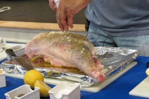 adding the minced garlic to the leg of lamb