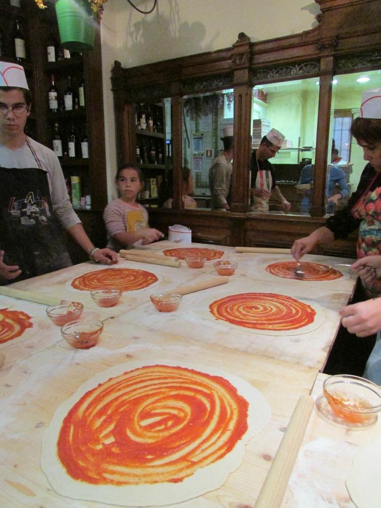 Baby Boomer Travel   Italy   Swirling Tomato Sauce - Pizza Making - Rome
