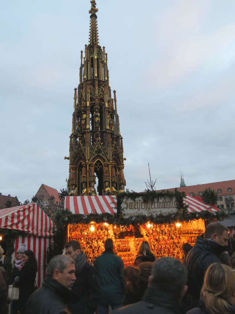 The cathedral spire looms over the Nurnberg Christmas Market in #Germany #Nuremberg #Cathedral
