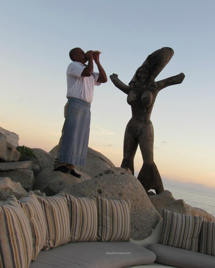 Blowing the Conch Shell at Sunset - Sunset Da Mona Lisa