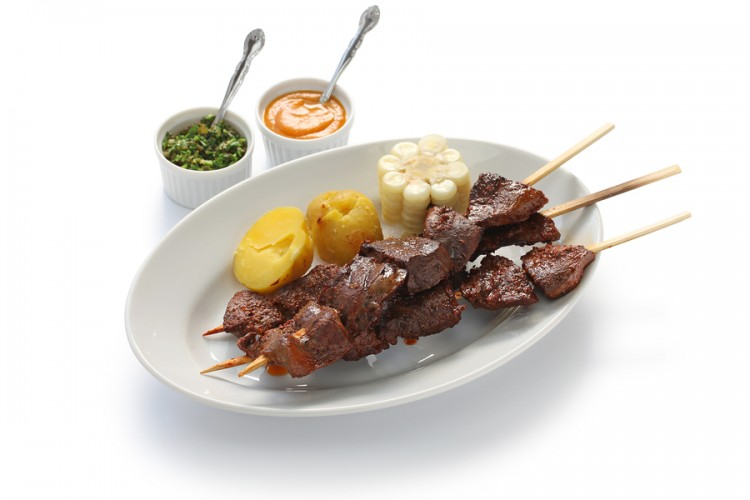anticuchos, Peruvian cuisine, grilled skewered beef heart meat with boiled potato and white corn