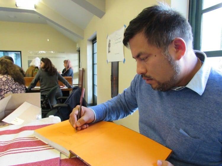 Ricardo Zarate signing his book
