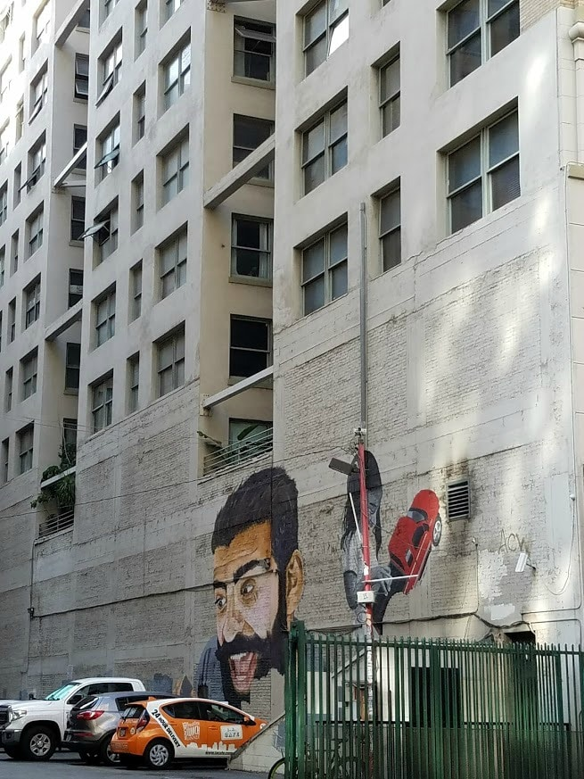 Baby Boomer Travel | Street Art | Man and Girl Mural in Parking Lot