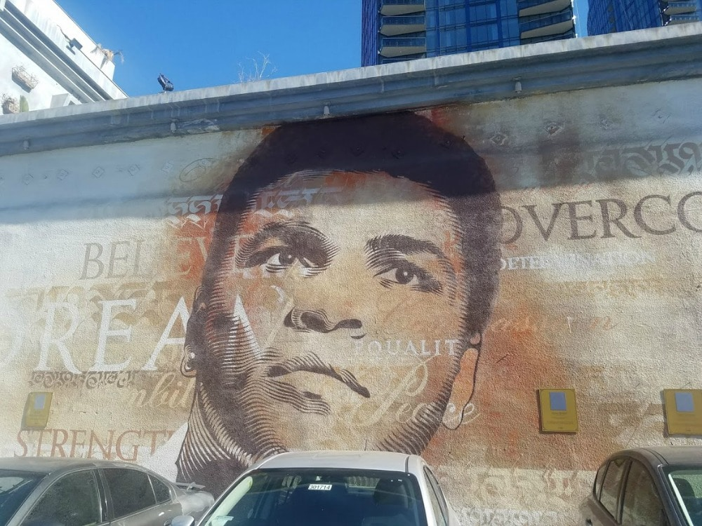 Baby Boomer Travel | Street Art | parking lot - Muhammad Ali