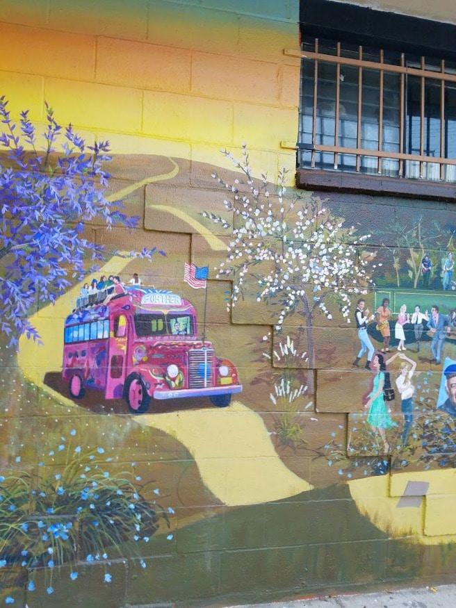 Baby Boomer Travel | Street Art | Tour Bus - Iliad Bookstore - NOHO bikepath