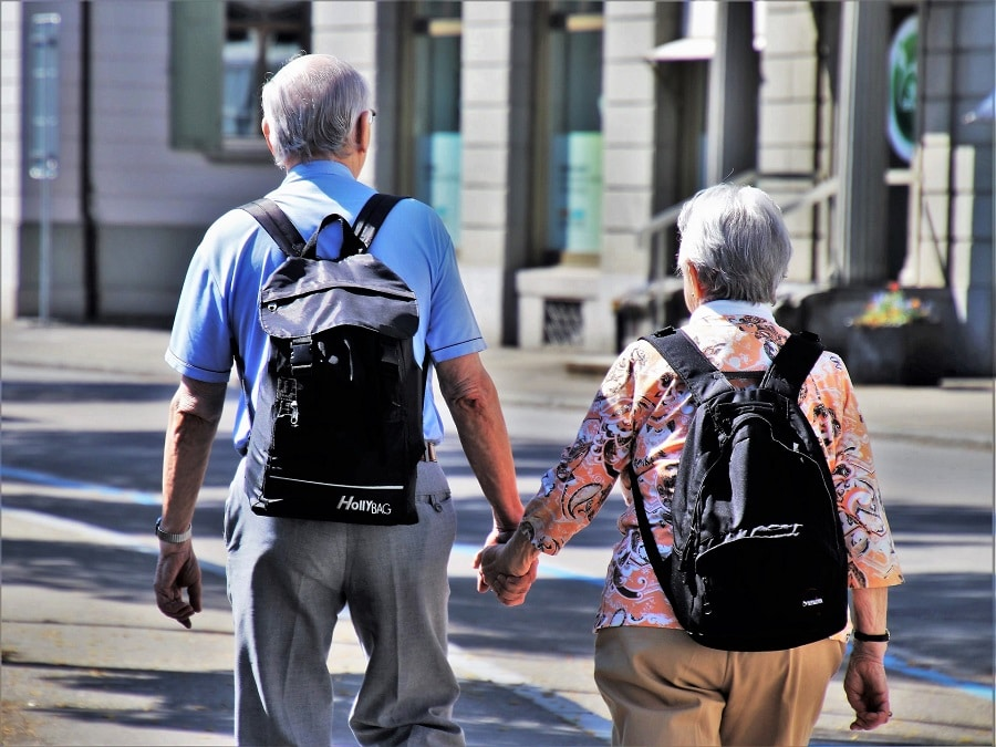It's not necessary to have lots of stuff when you travel. These Baby Boomer travelers are using backpacks to explore new places.