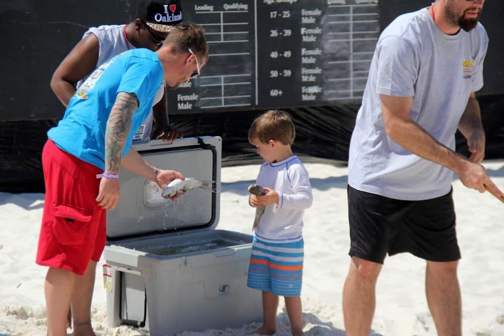 An Alabama boy picks out his fish for the Flora Bama's annual mullet toss #Alabama #Florida #Bushwackers #FloraBama #fishtoss