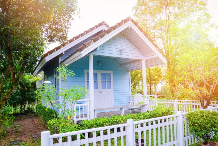 This adorable Granny pod has a picket fence and looks like a cottage. A granny pod is a tiny house that can be installed in a backyard or other area and is becoming popular for single retirees.
