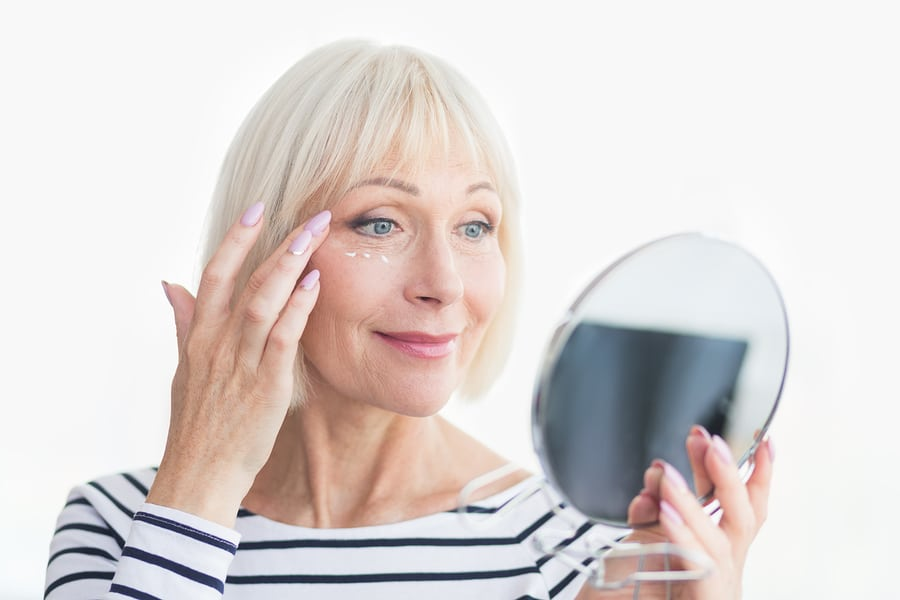 Skin care with mature woman