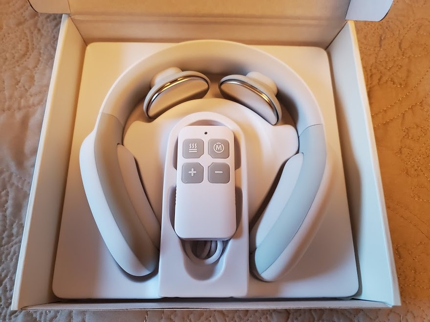RelaxUltima neck massager in open box
